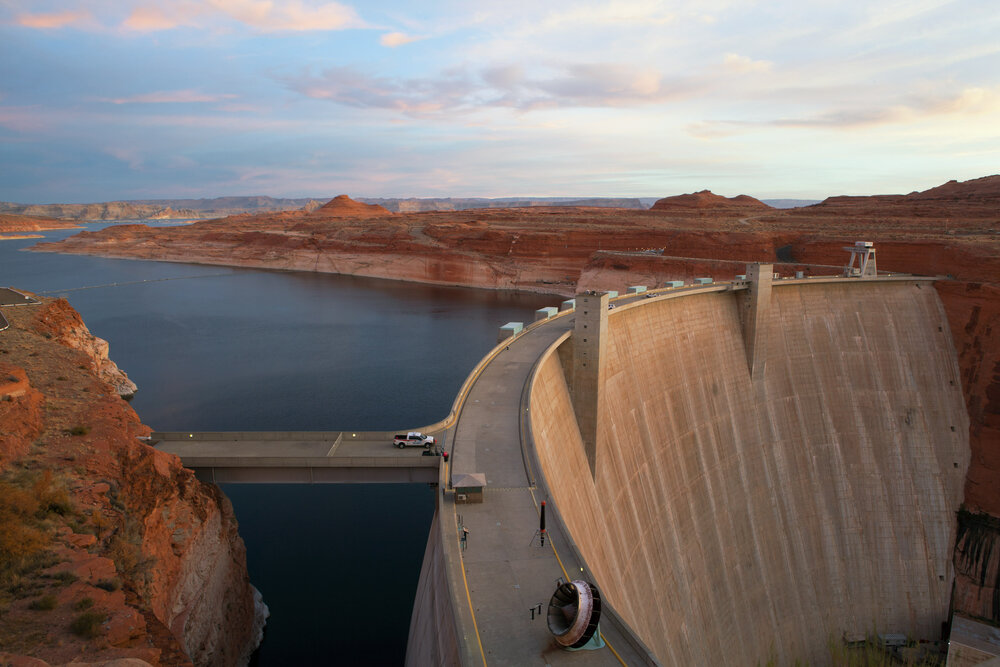 The Glen Canyon Dam opened in 1966 is a key component in the Colorado River Storage Project, regulating water distribution between the 7 US states and Mexico that claim rights to the river's water. The dam flooded Glen Canyon creating the sink that is 'Lake Powell'. The 1922 Colorado River Storage Project from which Glen Canyon Dam was born overestimated river flow, underestimated human use and couldn't foresee the impacts of climate change. There are 15 dams on the main stem of the river and hundreds on it's tributaries.