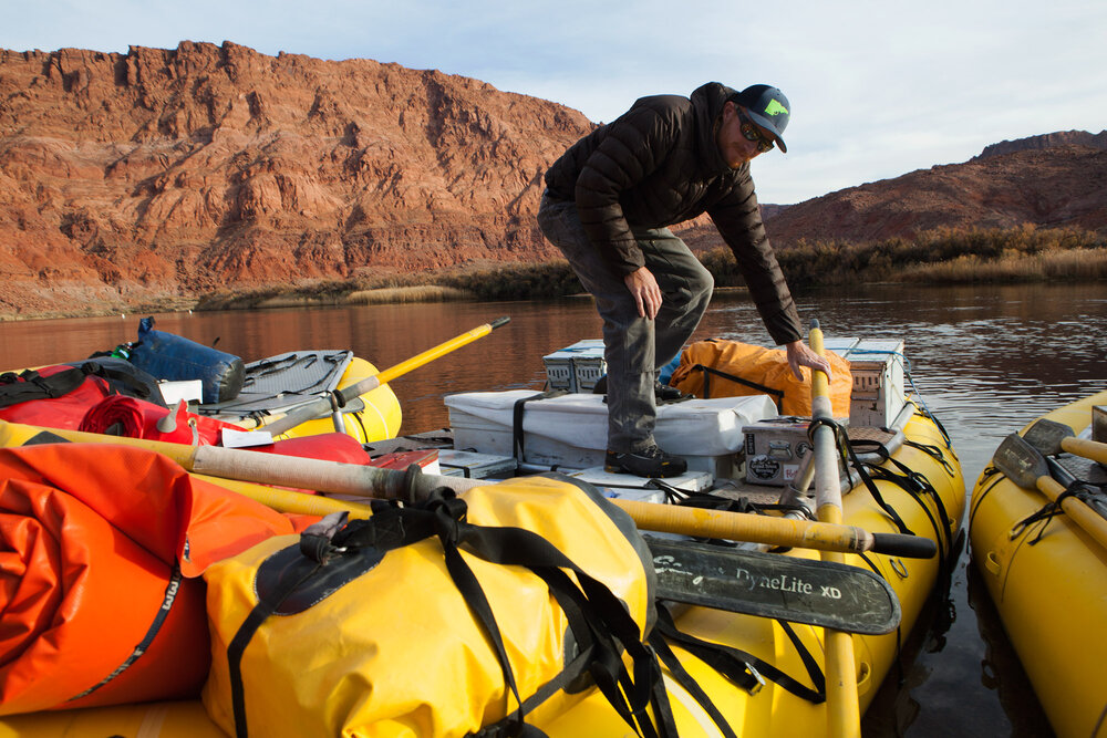 Stephen Wilmeth from Riggins, Idaho prepares for a 22 day run down the Colorado at the historic put in point at Lees Ferry in Arizona. Recreation on the river and it's tributaries generates approximately $28 billion annually.
