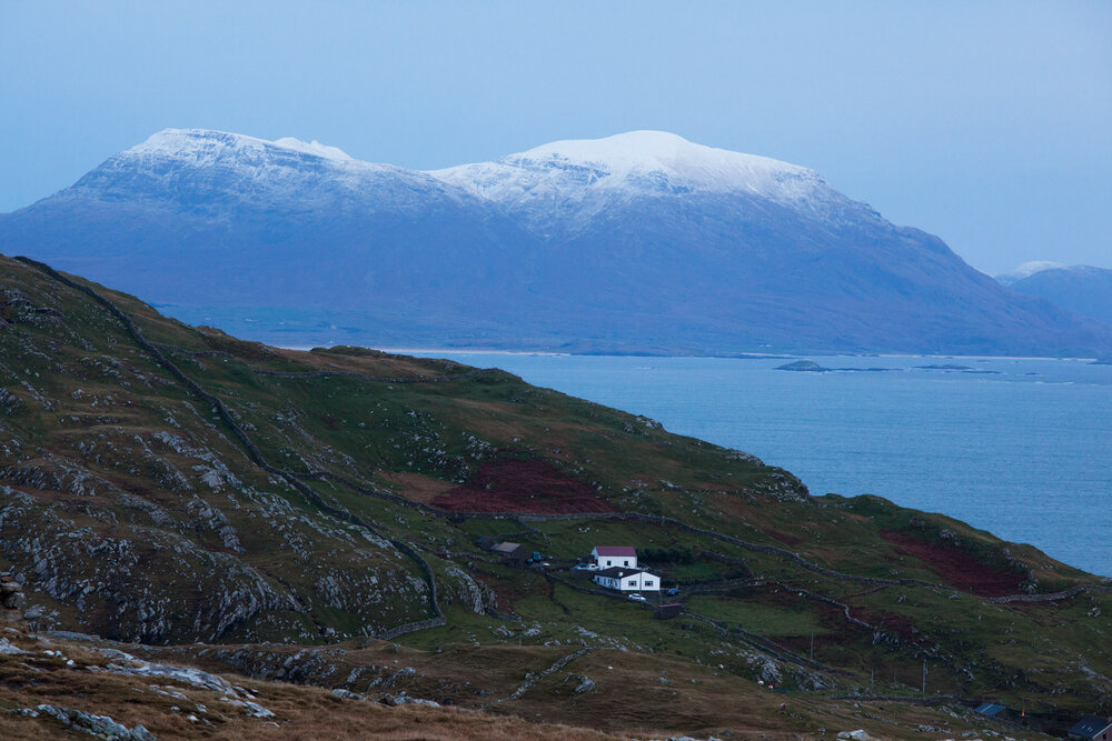 Looking eastward across the island toward the Irish mainland and the snow topped mountain of Mweelrea County Mayo's highest peak.