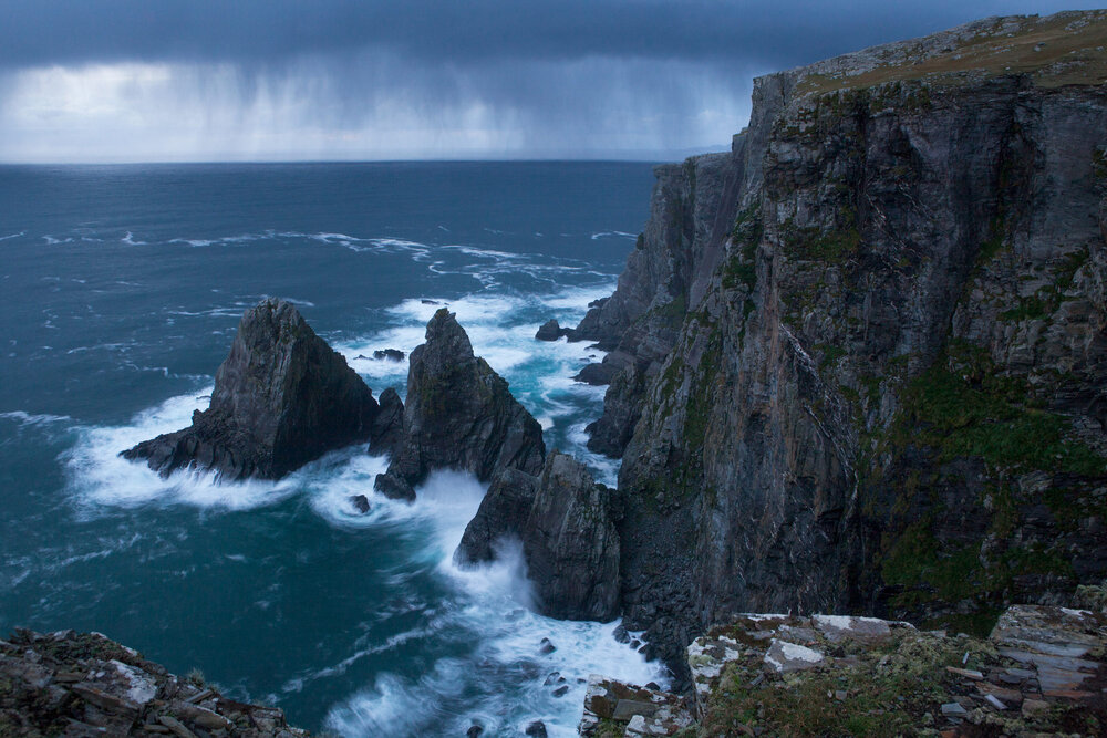 The rugged coastline of cliffs and sea stacks take a beating as an Atlantic storm moves in on the western side of the island.