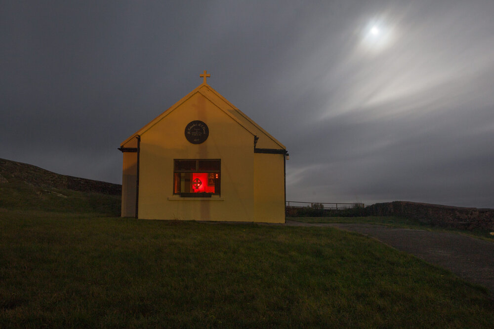 The Catholic church on Inishturk under a full moon. Every 3 weeks a priest comes to the island to offer mass. The rest of the time mass is led by the people of the island.