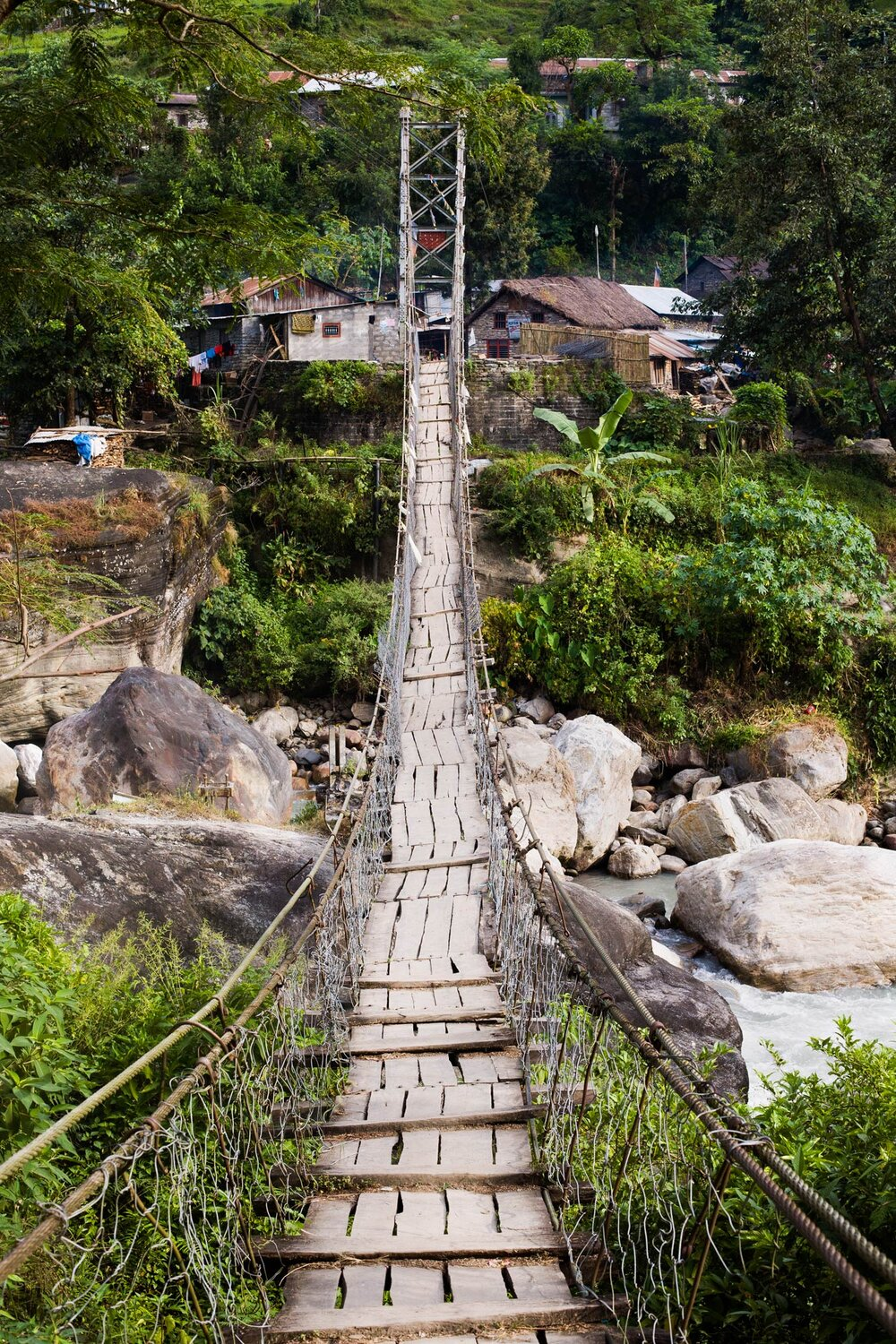 Footbridge in the foothills. Annapurna region