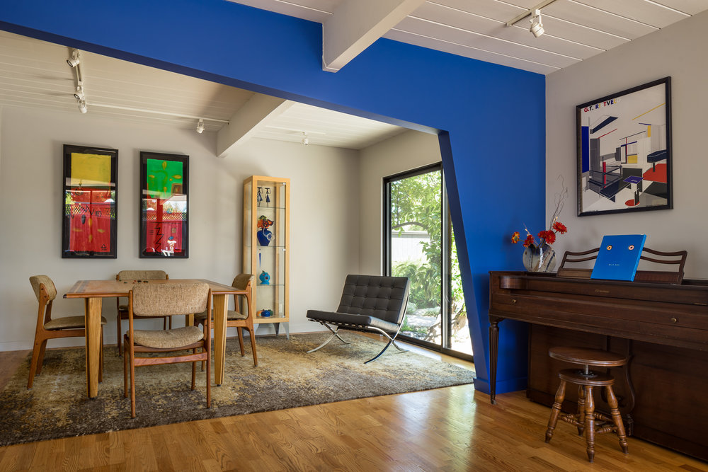 """My play on the """"sloped"""" dividing wall, which has a large beam running across it through that form, was a tribute to Sandy Calder. Painted in """"Norma Blue""""."""