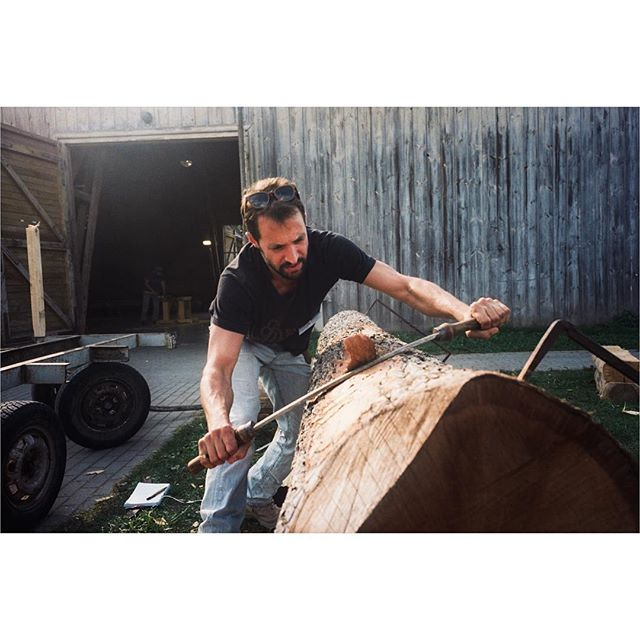[Timber Framing and Log Cabin workshop in Ratnieki, Latvia.] ::: Alan stripping a log to be prepared for the cabin. ::: #timberframe #northmen #latvia #logcabin #handtoolsonly #film #ricohgr1 #portra400 #filmisnotdead #filmphotography