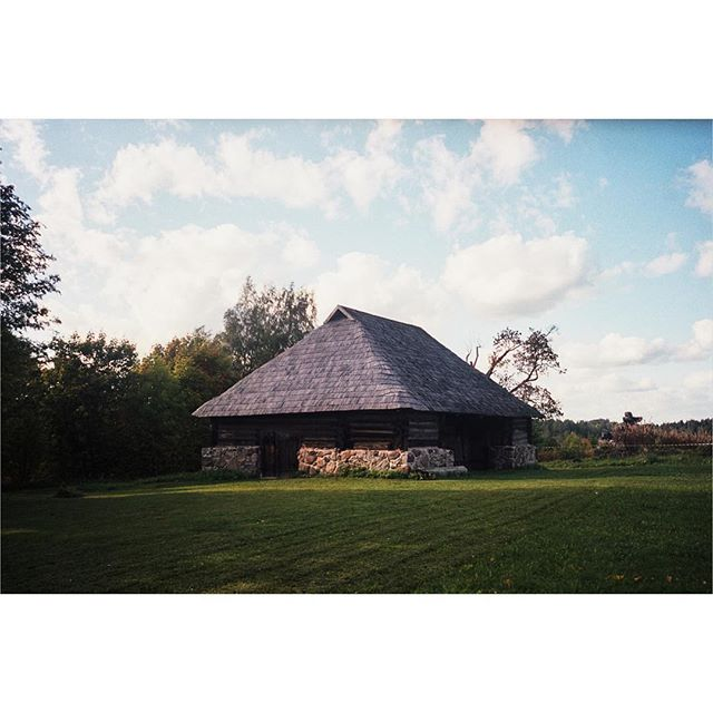[Timber Framing and Log Cabin workshop in Ratnieki, Latvia.] ::: Here's a look at a traditional Latvian Home. I see a version of this everywhere I've ever traveled to. It may not have ice cold air conditioning or lights that you can turn on with your iPhone but I think I'd much prefer this. ::: #timberframe #northmen #latvia #logcabin #handtoolsonly #film #ricohgr1 #portra400 #filmisnotdead #filmphotography
