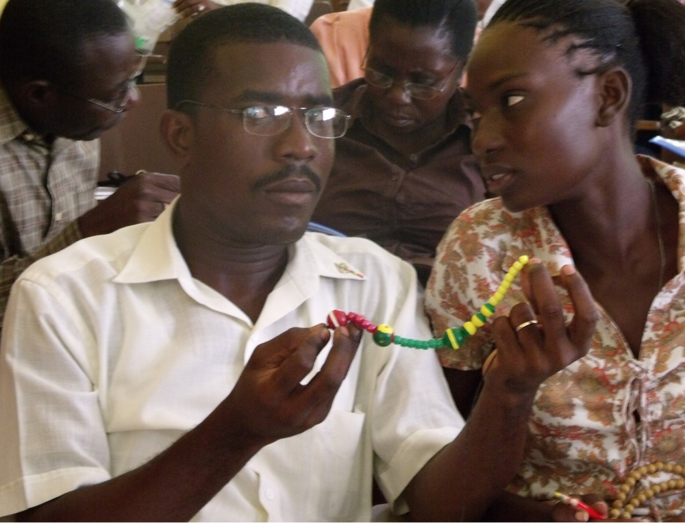 A couple learning about natural family planning with the bead method.