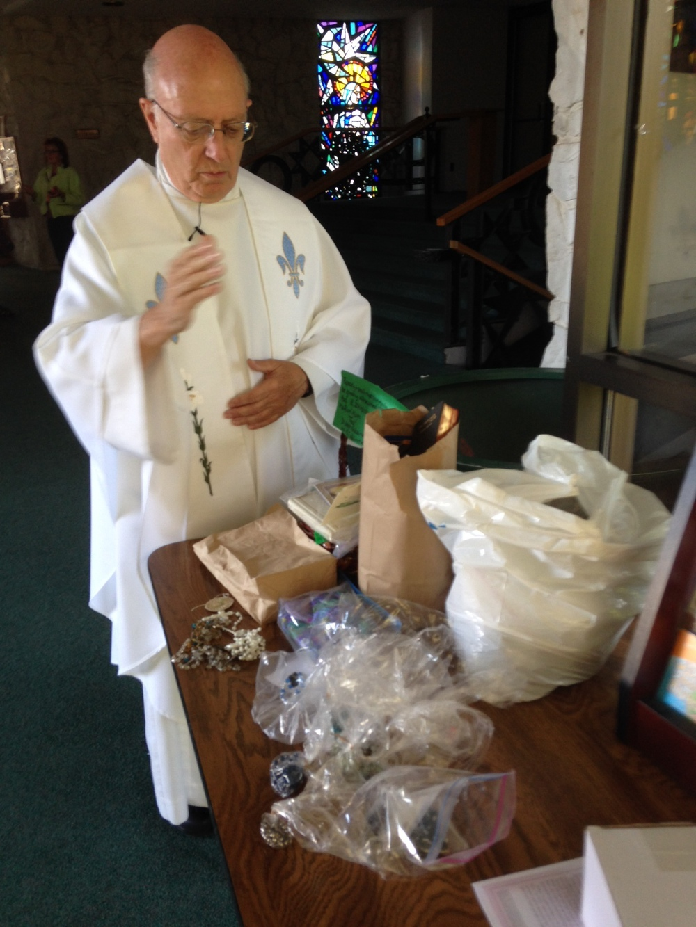 Here is Father Thomas Haffey at St. Ann's Parish, blessing rosaries and sacramentals that have been donated by so many people. Liam and I are going to share these with all of the members of the training.