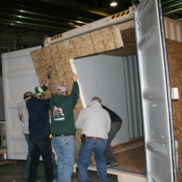 Photo Caption:    Students from Highlands College assist in construction of MLI's Mobile Maternal Surgical Unit