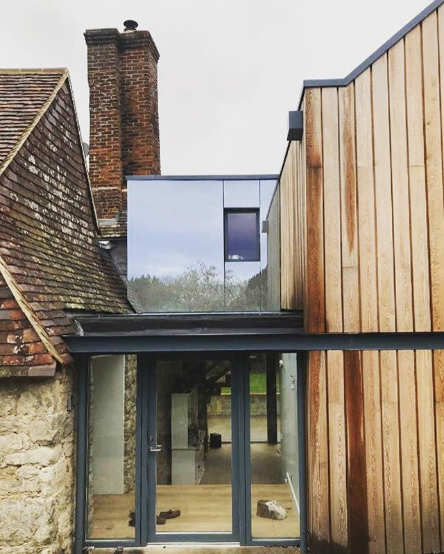 Siberian larch, steel and glass used to create this stunning contemporary extension that both respects the traditional Kentish style and character of the Grade II listed building whilst enhancing its beauty. #architecture #listedbuilding #kent #uk #contemporaryextension #larch #glass #steel