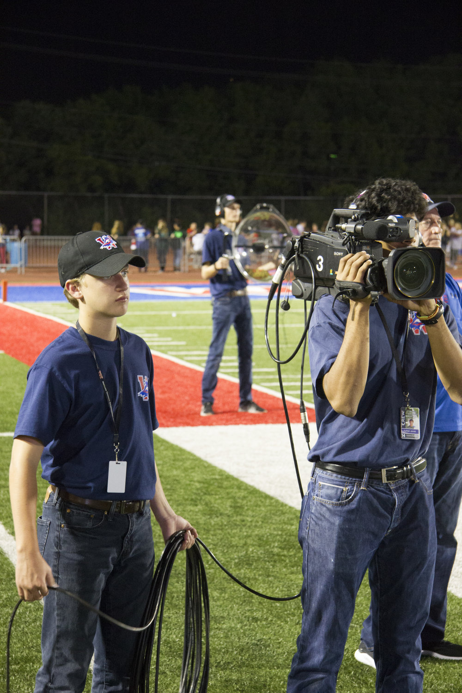 Farhan James Operating Shoulder Camera with Luke Beasley.jpg