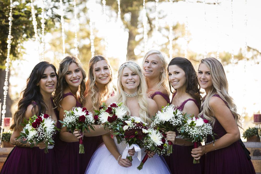 bridal-party-bridesmaids-posing-with-bride-1.jpg