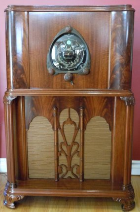 "This is an extremely rare 1938 Zenith model 15U271. This is the mahogany version of the 15U270 walnut model. The 15 tube 'Robot-Dial' console in a walnut finish is the more common version of this cabinet style. The original cost of the 15U271 was $235.00, $10 more than the 15U270 at $225.00. Some of the most serious Zenith radio collectors in the world have never seen this version in person. The 15U270 & 15U271 are the only 1938 15 tube Zenith radios that utilize two speakers, a 12"" woofer and a 6"" tweeter. Many of the surviving 15U270 and 15U271 suffer from cracking burl on the curved areas on each side of the dial. During the restoration process these areas were repaired. The chassis on this one still has it's model stamp 271. The cabinet paper tag has the model 15U270 crossed out in pencil and hand writhen 271. This was a common practice since Zenith never printed 271 paper tags. They made very few and did not want to go thru the trouble printing model tags. The large black Zenth dial is in perfect shape. The cabinets' mahogany veneer is beautifully restored with a flawless satin lacquer finish. The grille cloth is a reproduction of the original pattern. The knobs are the original wood Zenith knobs. The superhetrodyne chassis is a performer and plays full dial scale, loud and clear. The radio has had a complete recap electronic restoration - all the electrolytic caps were replaced with new production parts. All the paper foil capacitors were replaced as well. The dial belts are new for smooth motor operation and tuning. The chassis is clean and rust free. The radio has very nice reception with no hum."