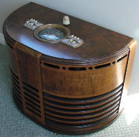 Zenith model 10S452 produced in 1940. Zenith chairside radio production started in 1937 and end in 1942. They were not popular with the buying public and very few were produced over the years. As with anything with low production numbers make it rare and collectible. All large tube count Zenith chairside radios are in high demand now. Keep in mind the cabinet design of a chairside traps and holds heat. Yes Zenith did provide ways for heat to escape, but heat is still trapped. I am sure many failures came about because of this trapped heat. Also I'll bet some spilled glasses of liquid might have caused some failures too.