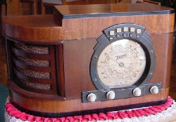 "I just love this 1939 Zenith 6S322. Zenith was famous for black dials. This is one of Zenith's attempts at a gold dial. This is a great example of getting it correct. This was Zenith first year for automatic push button tuning. This model series was also called ""Stars and Strips"" for the stars and bars stamped in the dial frame. Zenith made quit a few models in 1939 that collectors call ""Stars and Strips""."