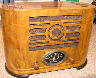 This is a 1937 Emerson model J106. The cabinet was manufactured my Ingraham. Wood cabinets made by E.Ingraham Co. like this radio are considered collectible in themselves. Ingraham's level of design and craftsmanship, their ability to contour wood panels was unequaled to others. Ingraham cabinet radios are among the highest valued.