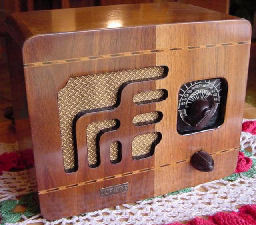 "Ultradyne is stamped in the brass name tag. I have looked in every radio book and Riders and this radio is no where to be found. I was in an antique store in Missoula Mt and I asked the owner if he had any radios. He picked up this little radio from the floor behind the counter and said like this. I said ""sure""! It was painted with a heavy coat black paint. Everything was painted name tag, knobs, dial, and grille cloth cloth. Well of course I bought it. I wasn't going to complain or haggle over the $10.00 he wanted for it. I was delighted to see the beautiful undamaged wood when I stripped the paint off. It too has a resistance line cord and plays very nice."