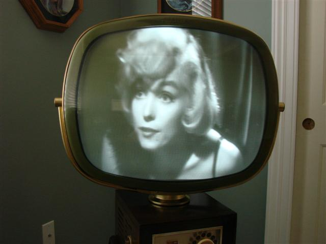 I purchased this Philco Predicta Danish Modern 1960 Model 4730 back in Dec 2008. The TV has been a very long process restoring. This was going be my first attempt at restoring a TV. I have been restoring radios for about 20 years so I know the basics. From what I have read, this is a hard to find model and somewhat a low production model too. Go figure I should find a nice one to start on. I was going to need some advice along the way of the restoration. I am a little rusty on video, horizontal, vertical, and all stuff in between. I do not have any of the necessary TV test equipment. I thought if I can handle fixing a radio, I could to this too. After weighting all these issues. I decided not to do the work my self. I sent the chassis and picture tube to a Larry Whitlock in Texas for restoration. This was back in January 2009. Larry did a fantastic job restoring the chassis. It has been a long time, but it is done now May 2009.  The chassis restoration went well. The picture tube was the problem. The tube I had was a rebuilt one from years back, and it was very weak. The only re-builder left in the country of PT's a company called Hawkeye. Larry had to send the picture tube to Hawkeye. First, one came back and sparked. It had a bad replacement gun. The second one imploded in Hawkeyes oven. The third was the charm.  I refinished the cabinet and reinstalled the chassis and picture tube. Knowing enough about TV's, to get myself into trouble, I made all the finial adjustment. It does work great!