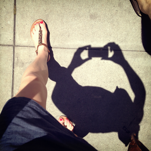 Feet with walking shadow