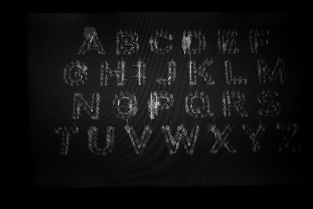 Long exposure alphabet created from the laser. Precision perfect becomes perfectly in-precise.