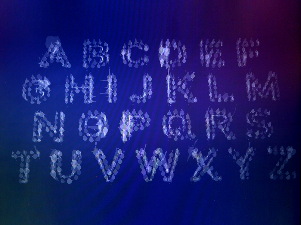 Long exposure laser cut alphabet at 30 seconds. Perfect!