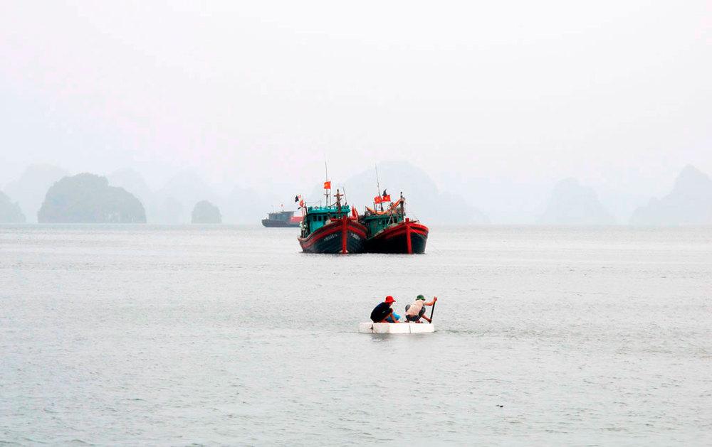 Fishermen in a porexpan diy boat #vietnam / sergivich.com