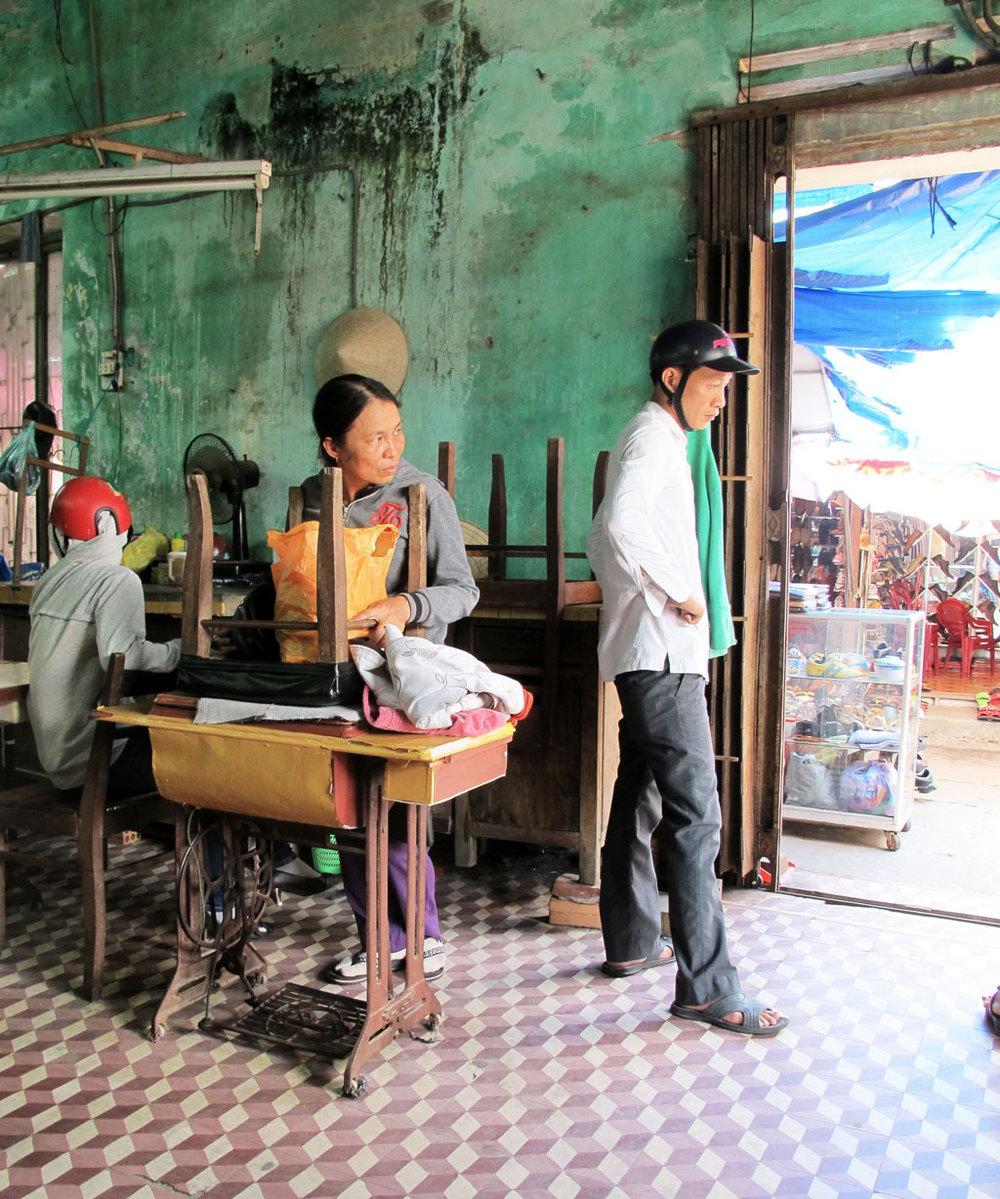 Silk weaver waiting their costumer with sewing machine #vietnam / sergivich.com