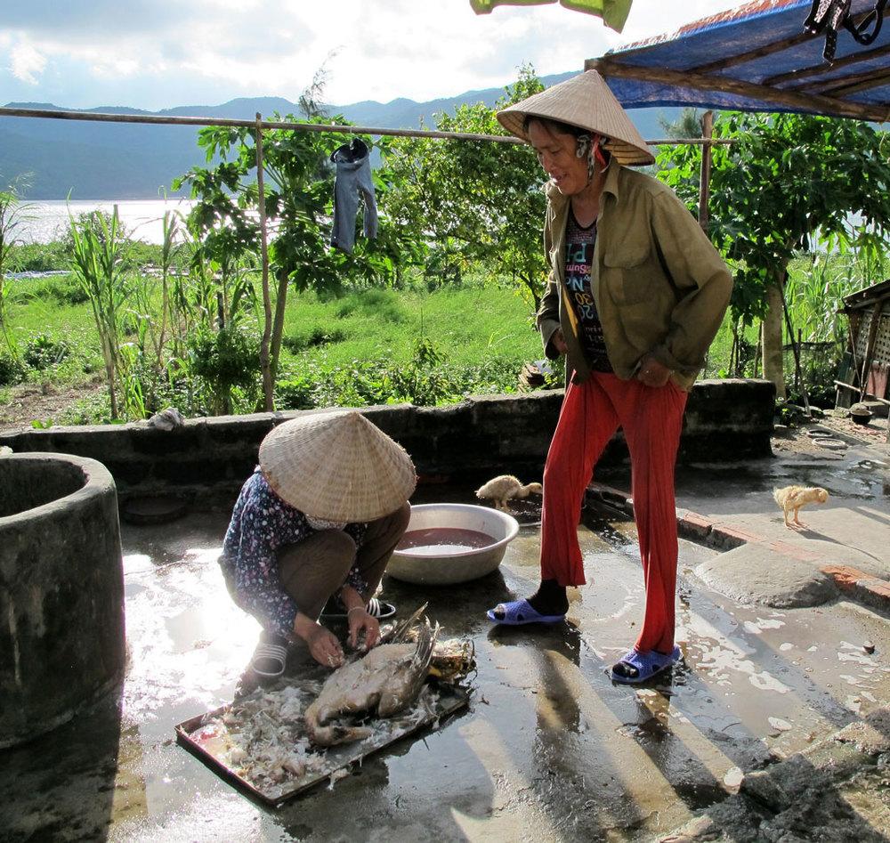 Ancient vietnamese with a plucked duck #vietnam / sergivich.com