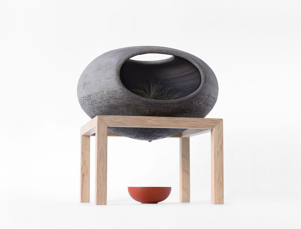 Wellspring by Martin Azua Studio. Handcrafted ceramic container on a wood structure. Photo by Sergi Vich