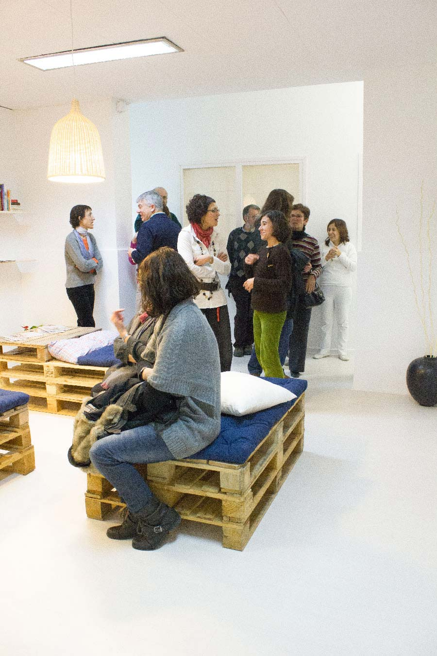 People enjoying and talking in the new meeting space of the yoga center