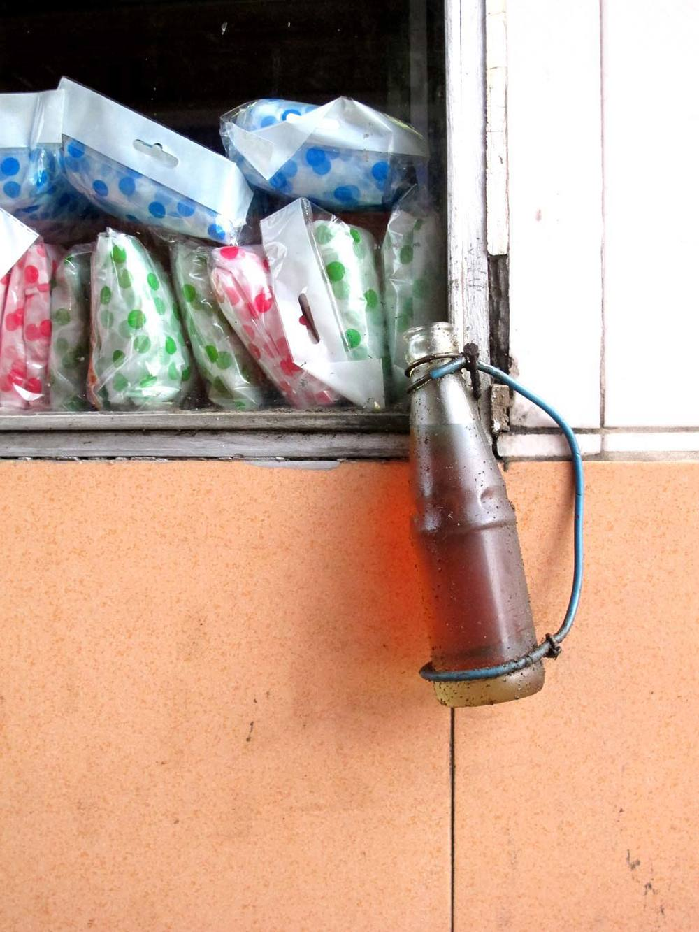 DIY liquid container of a glass bottle in a gas station. #VietnamInObjects / sergivich.com