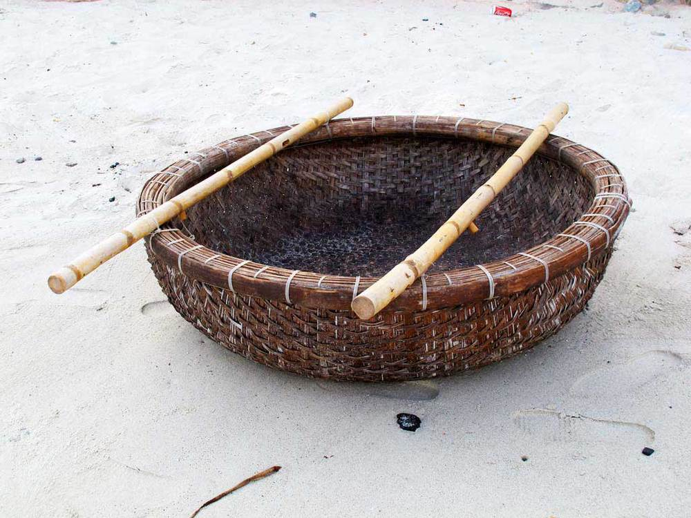 Basket boat in a beach crafted by vietnamese fishers. #VietnamInObjects / sergivich.com