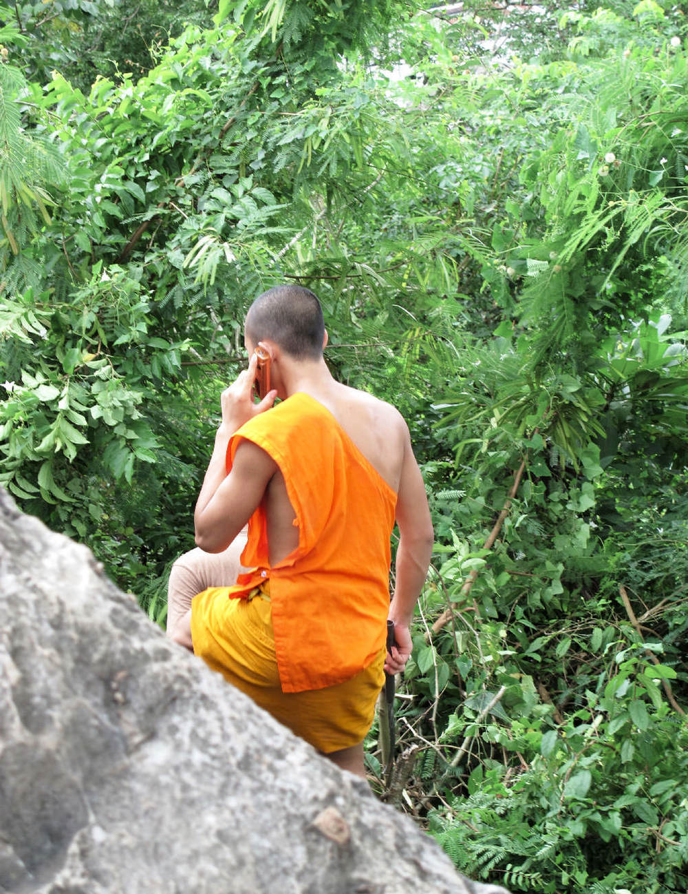 Monk cleaning the jungle with a bowie knife and calling #laos / sergivich.com