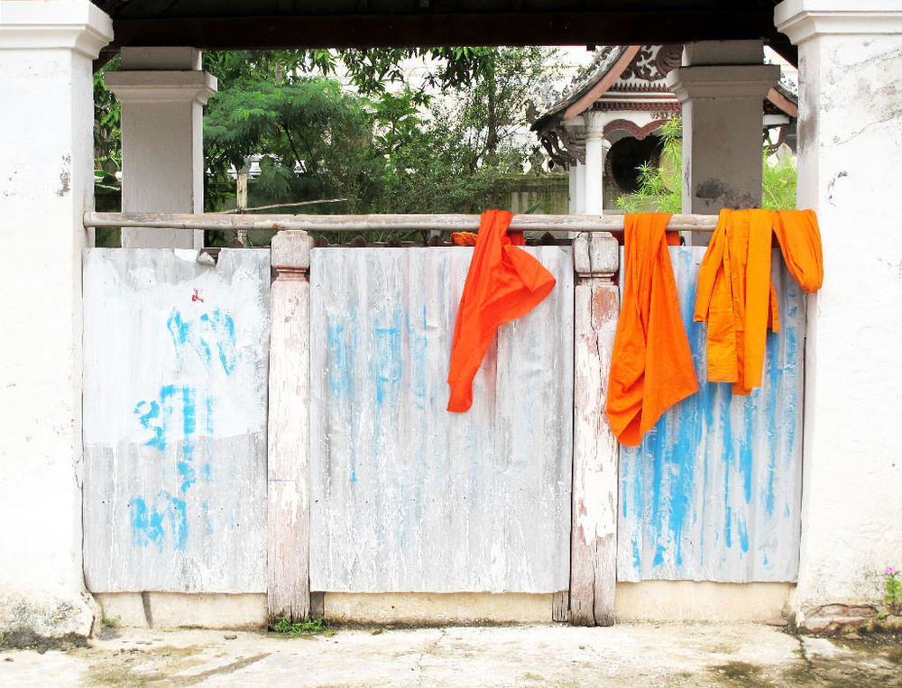 Monk dresses drying in a temple #laos / sergivich.com