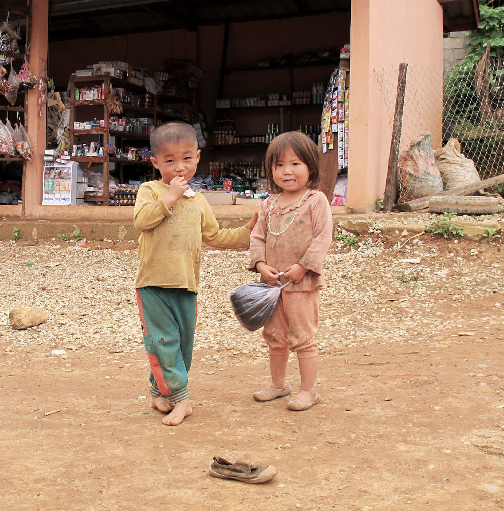 Two friendly kids in a town. Brown colors of #laos / sergivich.com