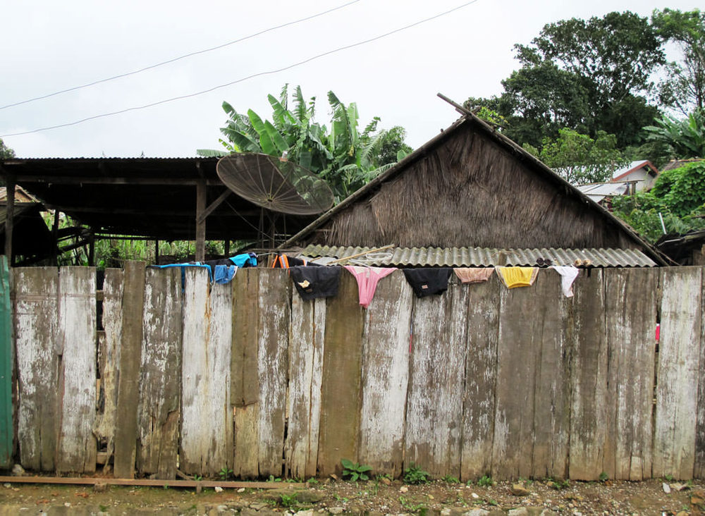 Wood fence with drying clothes in #laos / sergivich.com