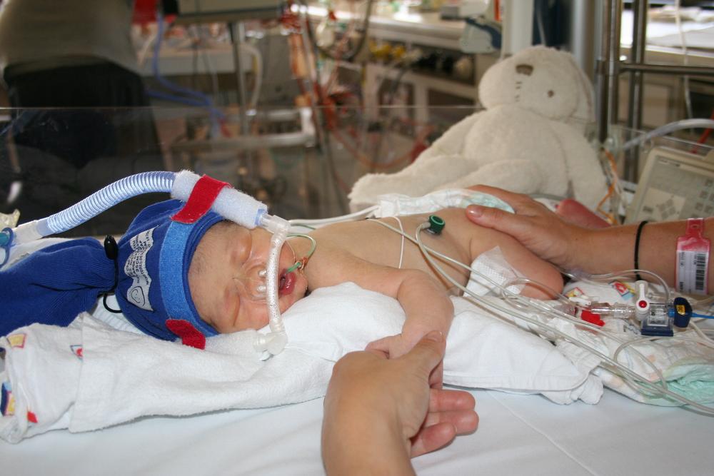 Mummy holding Xavier's hand