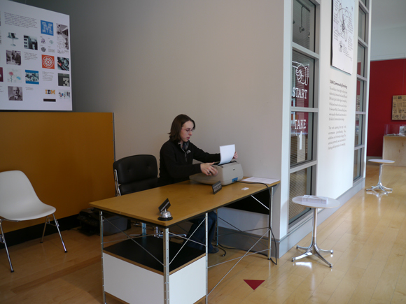 Laura Martini at desk in the LUNAR lobby