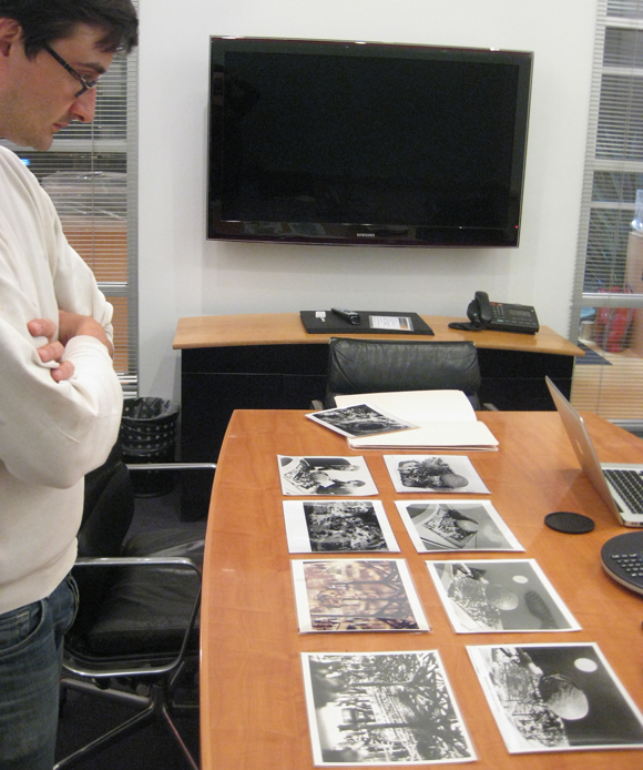 Michael Turri Looking at Photos