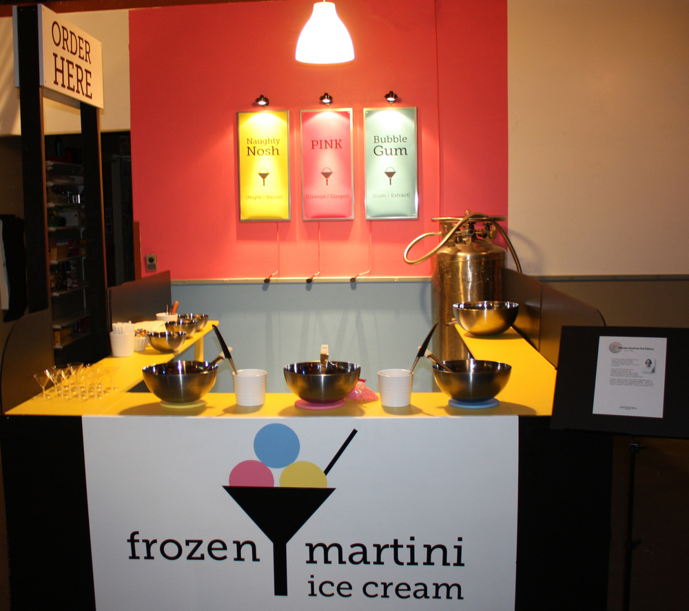 This is the stand on the night of Personal Statements, ready to go. Check out the Liquid Nitrogen Dewar in the back corner and the color-coded ice cream bowls. Up front is where the ice cream making happened. The batches were then transferred to the smaller bowls on the side for serving.