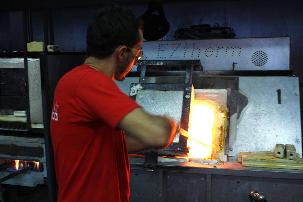 The process starts when Esteban takes some glass from the main furnace, which holds a big bowl of melted glass.