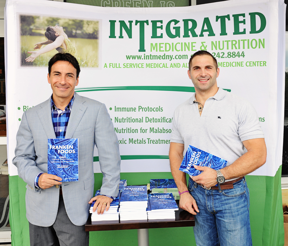 Dr. Michael Wald poses for a photo with Tim, his sports nutrition intern, at Mrs. Green's Natural Market in Mount Kisco, New York before the start of his book signing.