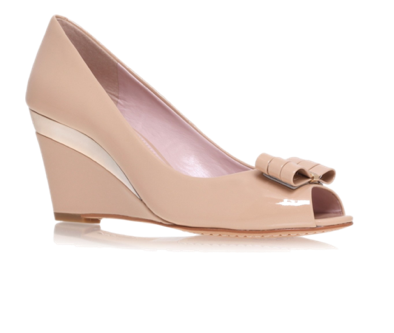 For a more comfortable heel, try the wedge. In the spring & summer, go for a peeptoe rather than closed-toe, unless your work environment does not permit it. I'm loving the flirty bow on these, by Vince Camuto.