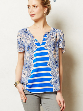This Anthropologie Archivist tee is the perfect short-sleeved option; made from super light, silky breathable fabric. The pattern is perfect to pair with a white slack or a colorful skirt/pant