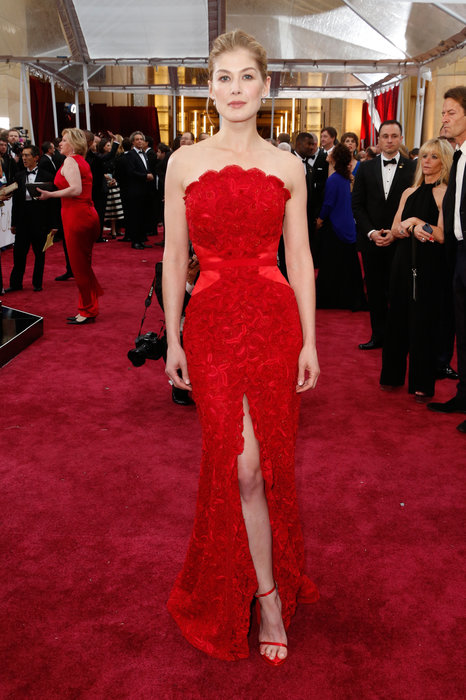 Rosamund Pike is RED HOT... The fabric change at the waistline also creates a slimming and figure-flattering effect and I am a sucker for a great red dress. The slit breaks up the dress perfectly; keeping it classy without going too high
