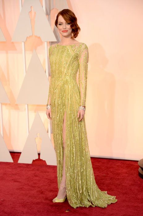 "Say what you will about Emma Stone's ""Poison Ivy inspired"" dress but I love it. Chartreuse is one of those colors that so unexpectedly looks good on so many different people; blondes to redheads, fair-skinned to darker skinned. I love the color, the detailing, the textures and the slit."
