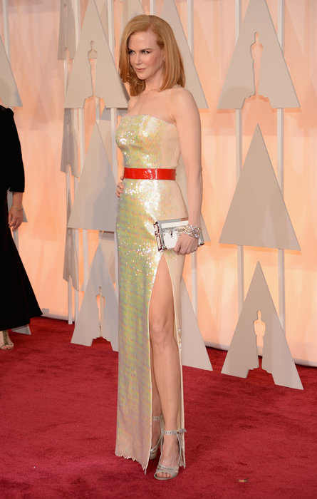 Ouch, my eyes hurt! This dress may have been okay had Nicole Kidman not had the bright red, pleather-esque belt around the middle. The iridescence of it all is a little bit juvenile to me, and the cut is the only redeeming aspect of this look. The belt ruined it all for me, therefore putting her in my Worst Dressed category.