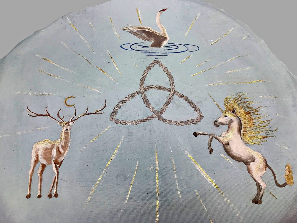 A shield depicting spirit animals for a friend