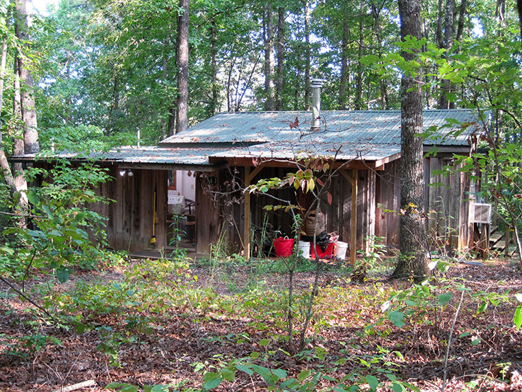 "The cabin from the area between buildings. There are three buildings here: the cabin, blacksmithing studio, and ""the workshop building"" where I have my office."