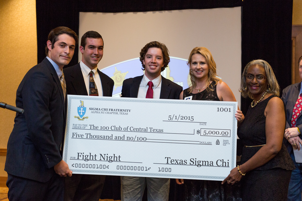 We were pleased to present the 100 Club of Central Austin with a check for funds raised from Fight Night.