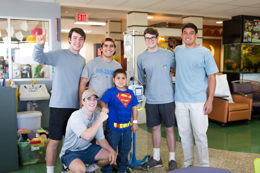 Ben Norton, Evan Amann, Ricky Martinez, Alex Dieste, and Tim Davis pictured with B+ Hero Nicholas